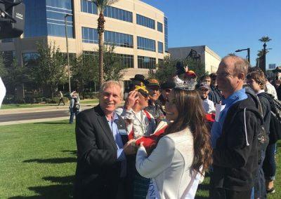 Dave Giles helping Fold USS Arizona Flag with Miss Arizona