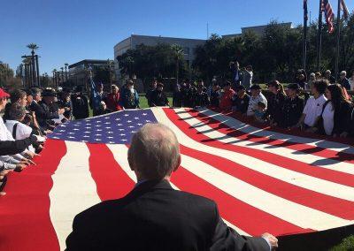 Dave Giles helping Fold USS Arizona Flag